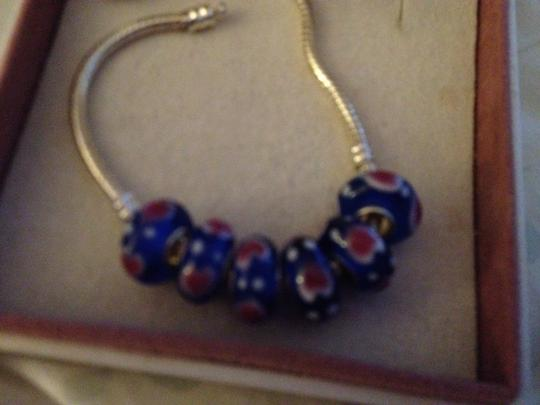 Preload https://item3.tradesy.com/images/royal-blue-with-red-hearts-white-polka-dots-set-of-6-european-style-murano-lampwork-glass-beads-4mm--2050477-0-0.jpg?width=440&height=440