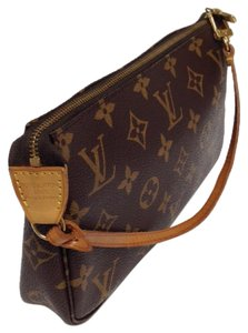 Louis Vuitton Hand Wristlet in brown