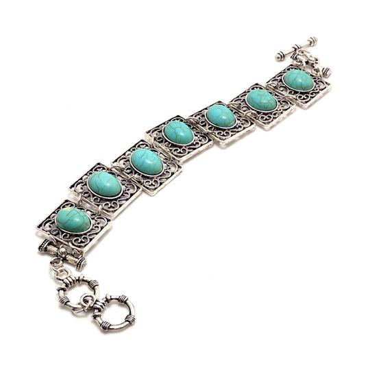 Preload https://img-static.tradesy.com/item/20507445/turquoise-silver-tone-antique-square-with-toggle-closure-bracelet-0-0-540-540.jpg
