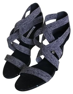 Manolo Blahnik The overall color tends toward a dark blue Wedges