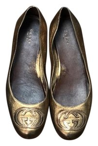 Gucci metallic bronze Flats