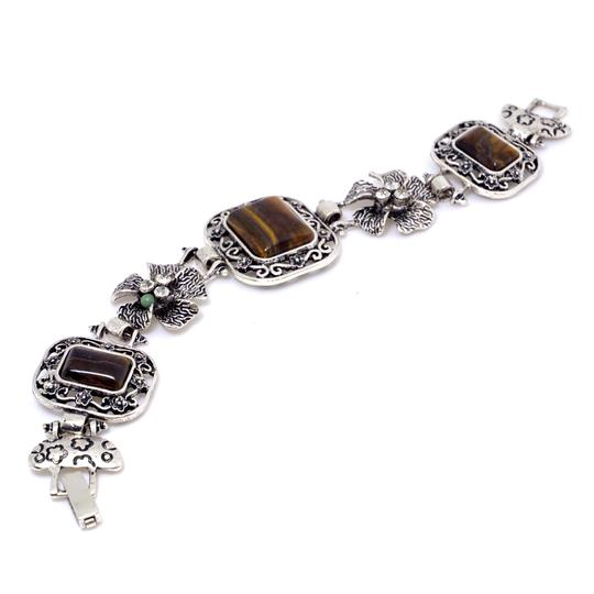 Preload https://img-static.tradesy.com/item/20508537/brown-with-natural-stone-accent-and-rhinestone-florets-bracelet-0-0-540-540.jpg