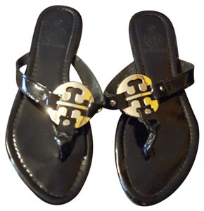 Tory Burch Black and Gold. Sandals