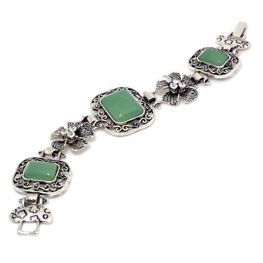 Preload https://img-static.tradesy.com/item/20508630/green-with-natural-stone-accent-and-rhinestone-florets-bracelet-0-0-540-540.jpg