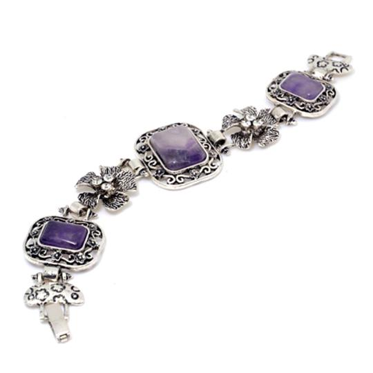 Preload https://img-static.tradesy.com/item/20508653/purple-with-natural-stone-accent-and-rhinestone-florets-bracelet-0-0-540-540.jpg