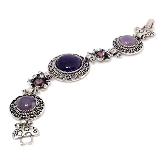 Preload https://img-static.tradesy.com/item/20508791/purple-with-natural-stone-accent-and-rhinestone-florets-bracelet-0-0-540-540.jpg