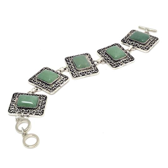 Preload https://img-static.tradesy.com/item/20508878/green-with-natural-stone-accent-and-rhinestone-florets-bracelet-0-0-540-540.jpg