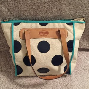 Fossil Tote in Cream with navy polka dots.