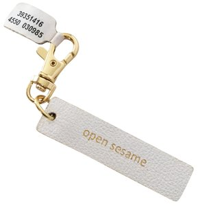 Anthropologie Open Sesame Leather Idiom Keychain Fob Charm Gold White