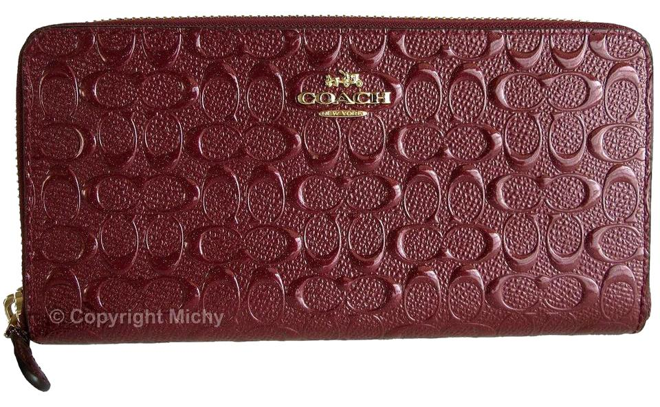 fe4d8e920be0 Coach Coach Signature Debossed Patent Leather F54805 Accordion Zip Wallet  Image 0 ...