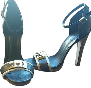 Tory Burch Navy blue and beige fabric details with gold hardware. Platforms
