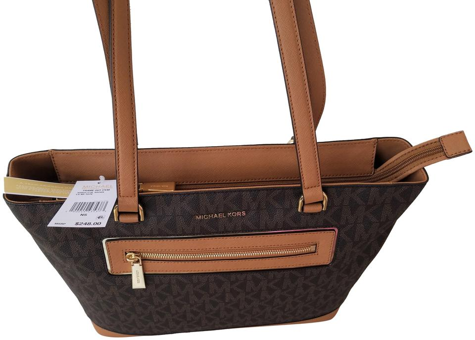 a667cc650490 Michael Kors Mk Signature Tech Friendly Gold Hardware Color: Tote in Brown  Image 0 ...