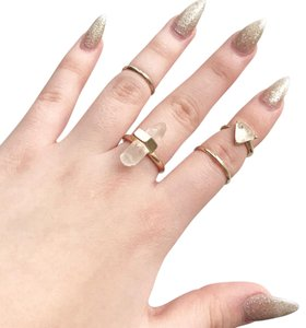 Urban Outfitters gold crystal rings set