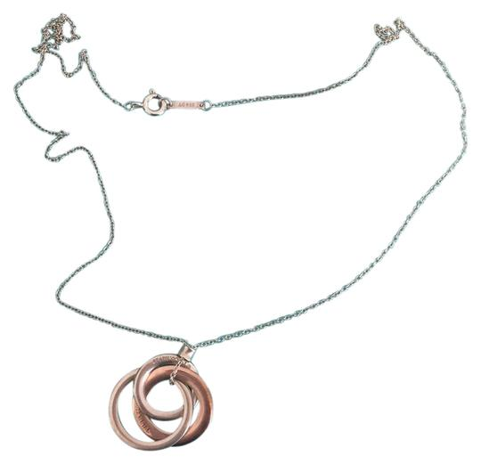 Preload https://img-static.tradesy.com/item/20524986/tiffany-and-co-silver-and-rose-gold-interlocking-necklace-0-1-540-540.jpg