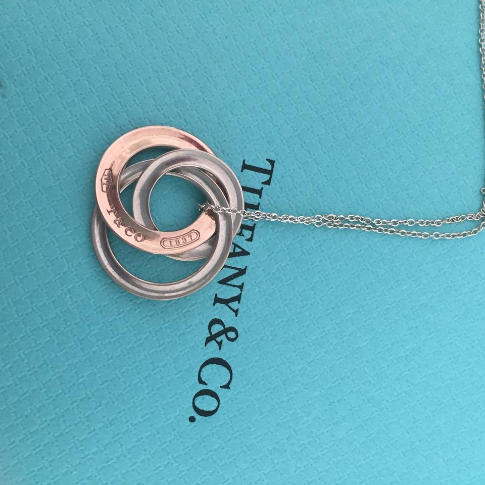 4fb83002d4b73 Tiffany & Co. Silver and Rose Gold Interlocking Necklace 37% off retail