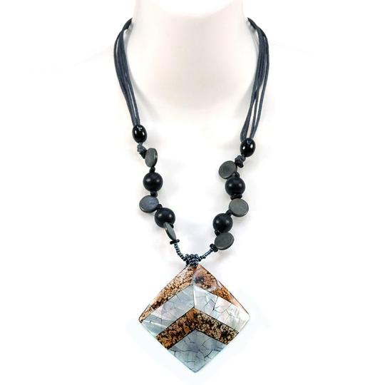 Preload https://img-static.tradesy.com/item/20525103/whiteblack-nature-inspired-bead-w-marble-and-shell-tiled-charm-necklace-0-1-540-540.jpg