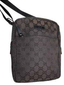 Gucci Messenger/Cross Body Unisex Style Great For Everyday Perfect For Travel Excellent Condition dark brown leather & brown large G logo print canvas with a nylon strap Messenger Bag