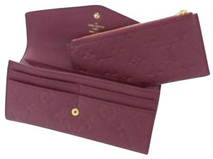 Louis Vuitton Long Envelope Empreinte Monogram Embossed Sarah