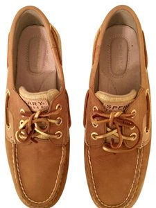 Sperry brown with gold accents Flats