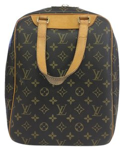 Louis Vuitton Lv Monogram Excursion Canvas Tote in brown