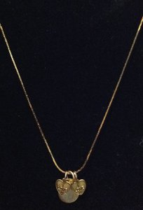 Other gold necklace with three charms