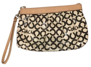 Coach Wristlet in Black, cream, tan