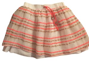 MILLY Mini Skirt White with neon orange and gold stripe pattern.