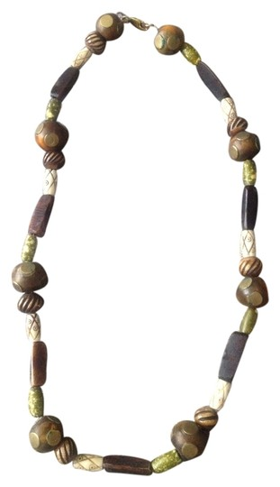 Preload https://item2.tradesy.com/images/brown-and-green-tribal-beaded-necklace-2053266-0-0.jpg?width=440&height=440