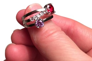 Other Sterling silver band style ring in garnet and amethyst.