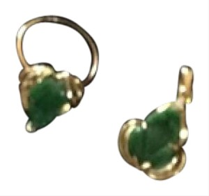 18 its a jade ring and pendent frog and diamond in 18k gold