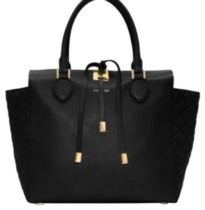 Michael Kors Satchel in Black with gold hardware.