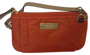 Tumi Wristlet in orange with nude color straps