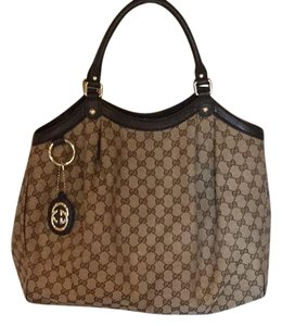 Gucci Tote in dark brown leather trim/ GG body