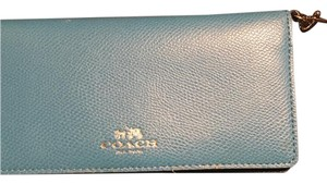 Coach Wristlet in Baby Blue exterior, Navy interior