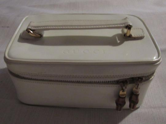 Gucci Petite But Roomy Dual Zip Closure Excellent Vintage Restored Lining Bamboo Accents Satchel in white patent leather Image 10