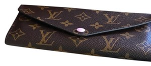 Louis Vuitton Wristlet in brown/Pink