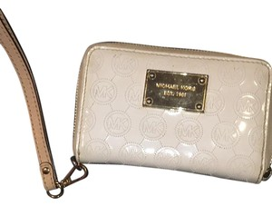 Michael Kors Wristlet in white and gold
