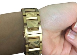 Burberry women's Swiss Gold Ion Plated Stainless Steel Bracelet Watch 34mm