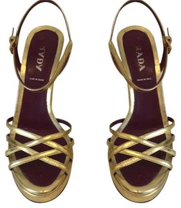 Prada gold Platforms