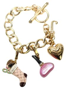 Juicy Couture RARE Golden limited edition charm bracelet