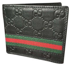 Gucci GUCCI EMBOSSED LEATHER BILLFOLD WALLET