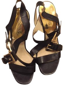 Michael Kors black with gold clips Platforms