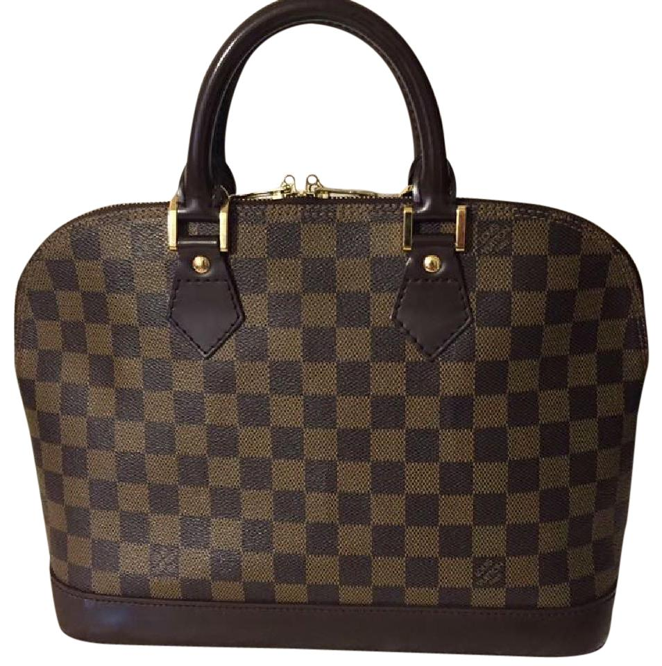 louis vuitton handbags on sale up to 70 off at tradesy. Black Bedroom Furniture Sets. Home Design Ideas