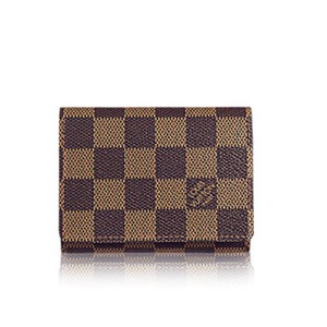 Louis Vuitton Business card holder. Damier Canvas grained calt leather lining. date code CA0195
