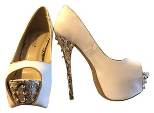 ShoeDazzle white with black and white snake print (gold spike detail). Pumps