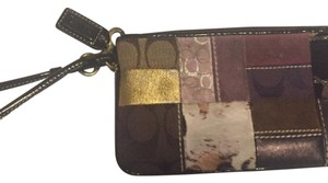 Coach Wristlet in brown gold purple