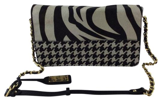 Preload https://item4.tradesy.com/images/badgley-mischka-genuine-dark-brown-leather-and-zebra-houndstooth-printed-cowhide-wristlet-20568148-0-1.jpg?width=440&height=440