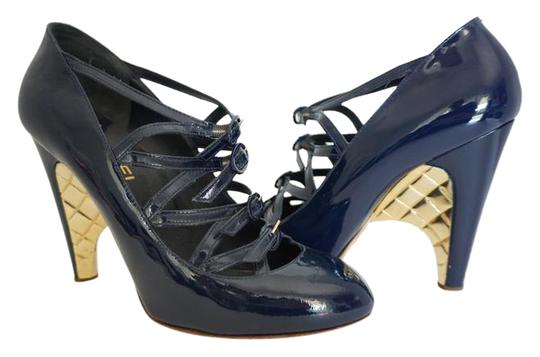Preload https://item4.tradesy.com/images/chanel-navy-blue-quilted-patent-leather-buckle-gold-40-pumps-size-us-10-20570753-0-1.jpg?width=440&height=440