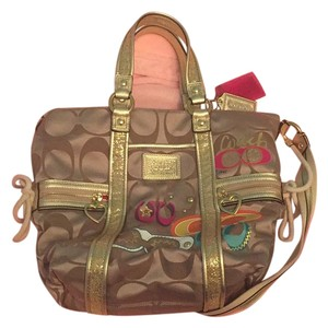 Coach Satchel in traditional C pattern with pink, blue, purple and orange colors