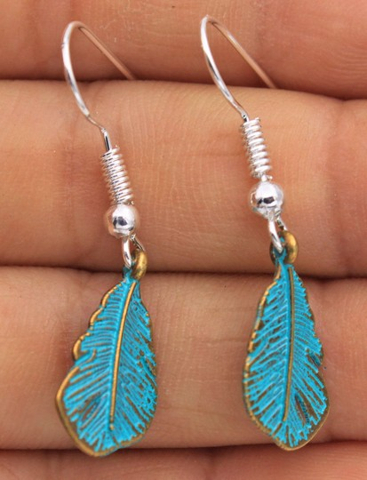 Preload https://img-static.tradesy.com/item/20571508/silverturquoise-bogo-free-patina-feather-metal-free-shipping-earrings-0-0-540-540.jpg